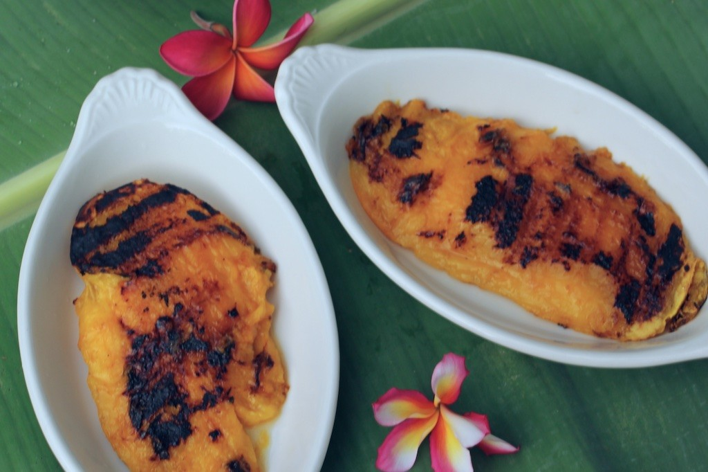 two grilled mango cheeks