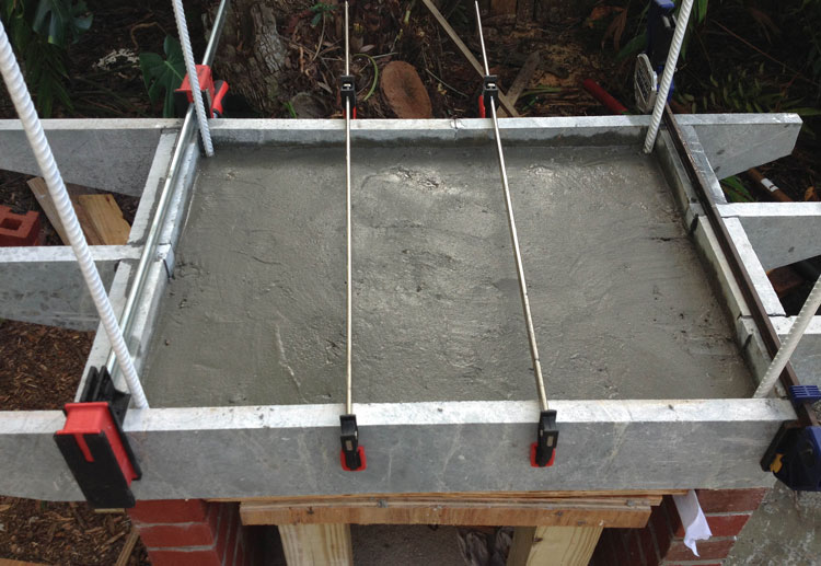 The concrete pour is reinforced with steel.